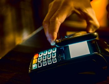 Contactless mobile payment. Payment terminal and smartphone in h